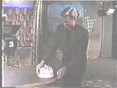 Craig with the 100th episode cake...a few seconds later he accidently drops it on the floor.